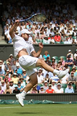 Andy Roddick stretches for the ball on the third day of Wimbledon.
