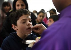 A Priest Serves Holy Communion On Ash Wednesday In West Bank