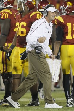 USC Lane Kiffin argues with the referees at the end of regulation against Stanford at the Coliseum in Los Angeles