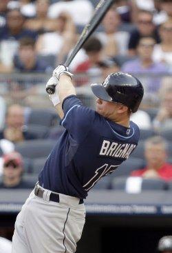 Tampa Bay Rays Reid Brignac hits a 3-run homer at Yankees Stadium in New York