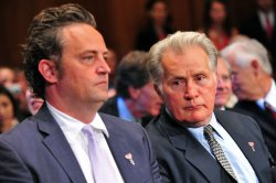 Actor Matthew Perry sits next to Actor Martin Sheen during a hearing on drug and veterans treatment courts in Washington