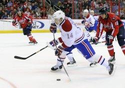 Canadiens Plekanec takes shot at Capitals goal in Washington
