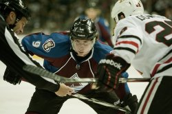 Avalanche Center Duchene Waits on Faceoff Against the Blackhawks in Denver
