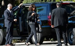 First Lady Michelle Obama and President Obama attend parent/teacher conferences