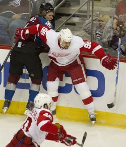 Avalanche Liles Loses Stick After Check by Red Wings Holmstrom in Denver