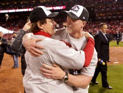 Cardinals manager Tony La Russa hugs batting coach Mark McGwire after winning the 2011 World Series in St. Louis