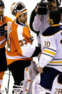 Flyers goalie Brain Boucher on the ice with Buffalo gaolie Ryan Miller after the game in Philadelphia.