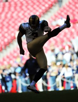Brown warms up before the Rams-Cardinals game in Arizona.