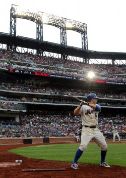 New York Mets starting pitcher Mike Pelfrey reacts after giving up a hit at Citi Field in New York
