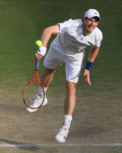 Rafael Nadal serves at Wimbledon.