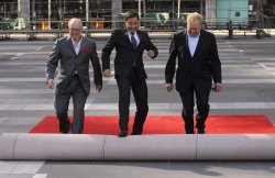 John Shaffner, Jimmy Fallon and Don Mischer roll out the red carpet as preparations are made for the 62nd Primetime Emmy Awards in Los Angeles