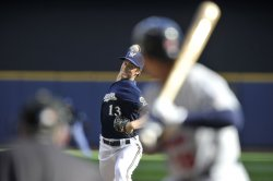 Brewers pitcher Greinke delivers against Cardinals during NLCS in Milwaukee, Wisconsin