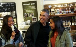 US President Barack Obama Shops With Daughters in Washington