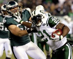 New York LDainian Tomlinson stiff arms Eagles Casey Matthews during second quarter play