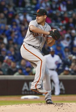 Giants pitcher Matt Moore pitches against the Cubs in Chicago