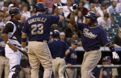 Padres Tejada High Fives Teammate Gonzalez after Two-Run Home Run Against the Rockies in Denver