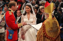 Prince William places a ring on Kate Middleton's hand at the Royal Wedding in London