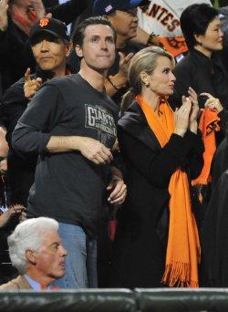 San Francisco Mayor Gavin Newsom and his wife Jennifer Siebel Newsom watch game 2 of the World Series in San Francisco