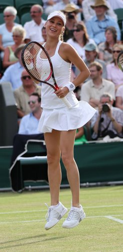 Kournikova smiles at the Wimbledon Championships