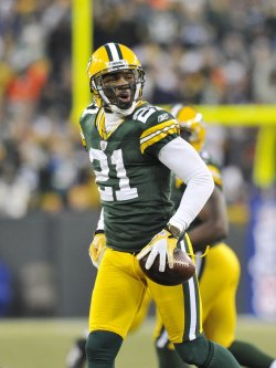 Packers Woodson celebrates interception against Raiders in Green Bay, Wisconsin
