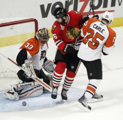 Blackhawks Bolland tries to score on Flyers during the 2010 Stanley Cup Final