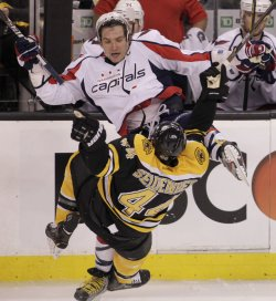 Capitals Ovechkin and Bruins Seidenberg collide at TD Garden in Boston, MA.
