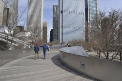 Pedestrians cross BP Pedestrian bridge in Chicago's Millennium Park