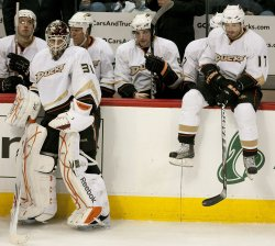 Ducks Goalie McElhinney and Visnovsky Rest during Timeout in Denver