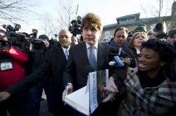 Blagojevich signs book after being sentenced to 14 years in prison in Chicago