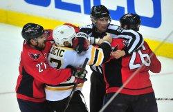 Matt Hendricks fights with Boston Bruins' Milan Lucic in Washington