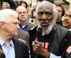 Activist Dick Gregory takes part in rally against Sudan in Washington, DC