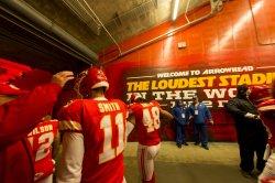 Kansas City Chiefs Andy Reid taps helmet of Kansas City Chiefs quarterback Alex Smith in Kansas City