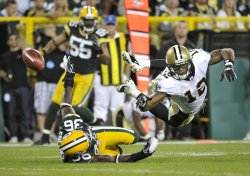 Packers Collins breaks up pass intended for Saints' Colston in Green Bay, Wisconsin