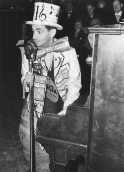 Songwriter Irving Berlin performs for Saints and Sinners Club in 1940