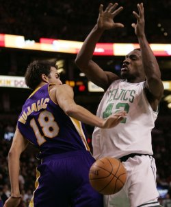 Lakers Vujacic swats ball from Celtics Allen in Boston, MA.