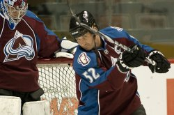 Avalanche Foote Clears Puck in Denver