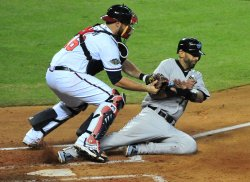 Brian McCann forces out Lance Jose Bautista during the 2011 All-Star game in Phoenix