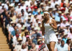 Sabine Lisicki celebrates a point in the Wimbledon Women's Final match against Marion Bartoli