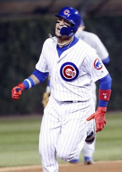 Cubs Baez watches second solo home run in the NLCS