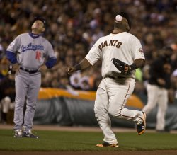 Giants Juan Uribe Pablo Sandoval blows a bubble in San Francisco