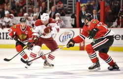 Coyotes' Whitney moves puck against Blackhawks in Chicago