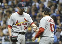 Cardinals' Manager Tony LaRussa relieves pitcher Marc Rzepczynski during game 6 of NLCS in Milwaukee, Wisconsin