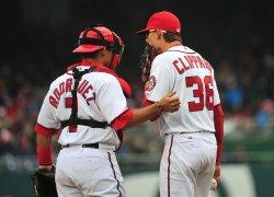Nationals' Tyler Clippard talks with catcher Ivan Rodriguez in Washington