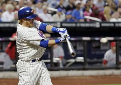 New York Mets Justin Turner hits an RBI single at Citi Field in New York