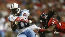 Houston Texans Dunta Robinson Grabs onto Tennessee Titans Rookie Kenny Britt at Reliant Stadium in Houston