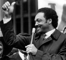 """Jesse Jackson gives the """"thumbs-up"""" sign on his arrival in Philadelphia for the Pennsylvania Democratic primary."""