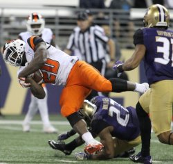 Oregon State Beavers running back Tim Cook score touchdown against the Huskies in Seattle
