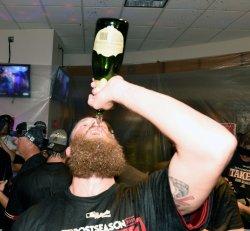 Diamondbacks' Bradley drinks champagne