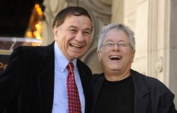 Alan Menken poses with fellow composer Richard Sherman after receiving a star on the Hollywood Walk of Fame
