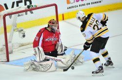 Bruins Daniel Paille shoots on Capitals goalie Braden Holtby in Washington